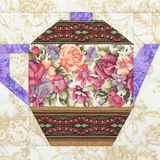 Patchwork block of the teapot with a pattern of flowers Stock Images