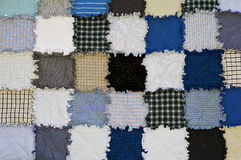 Patchwork. Blue and grey quilt patchwork texture background royalty free stock images