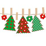 Patchwork with Christmas tree hanging on a rope in cloth pegs Royalty Free Stock Image