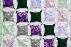Patchwork cloth. A pretty patchwork pattern in closeup Royalty Free Stock Photography