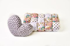Patchwork comforter and heart shaped pillow on white backgroun. Patchwork comforter and heart shaped pillow on white backgroun stock photos