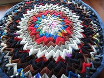 Patchwork cushion made of triangle patches Royalty Free Stock Image