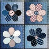 Patchwork de jeans avec l'applique des fleurs Images stock