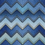 Patchwork of denim fabric. Seamless background pattern. Chevron patchwork of denim fabric Stock Photography