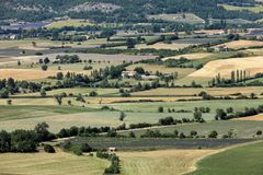 Patchwork of Farmer`s fields in valley below Sault, Provence. France Royalty Free Stock Photo