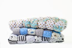 Patchwork and fashion concept - beautiful stack of colorful quilts, bedspreads stacked in several rows in height for storage, sale royalty free stock images