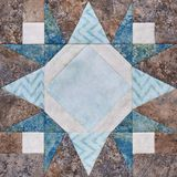 Patchwork geometric block from pieces of fabrics, detail of quil Royalty Free Stock Photos