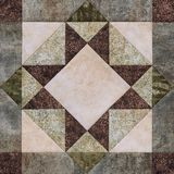 Patchwork geometric block from pieces of fabrics, detail of quil Royalty Free Stock Images