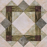 Patchwork geometric block from pieces of fabrics, detail of quilt Stock Photos