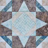 Patchwork geometric block from pieces of fabrics, detail of quilt Stock Image