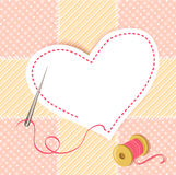 Patchwork heart with a needle thread Stock Photo