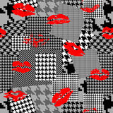 Patchwork of houndstooth pattern and lipstick imprints. Seamless background pattern. Patchwork of houndstooth pattern and lipstick imprints Stock Photography