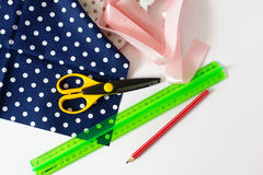 Patchwork items. Scissors, pink tape and red pencil on the white background Royalty Free Stock Photography
