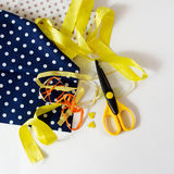 Patchwork items. Scissors, yellow tape and small hearts on the white background Royalty Free Stock Photos