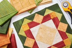 Patchwork orange-green block, quilting fabrics, sewing accessori Royalty Free Stock Photo