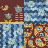 Patchwork pattern with blue flowers and paisley ornament. Royalty Free Stock Images