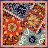 Patchwork pattern in ethnic style with flowers mandalas. Royalty Free Stock Image