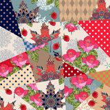 Patchwork pattern with roses, ornamental maple leaves, berries, polka dot prints. Stock Images