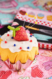 The patchwork pin cushion like a cupcake with strawberry Stock Photo