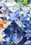 Patchwork Quilt. Miniature colorwash patchwork quilt, blue, gold, green and cream Stock Photos