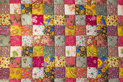 Patchwork quilt. Bright colorful patchwork quilt. Background stock photography