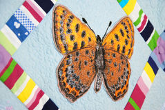 Patchwork quilt with butterflies. Colorful patchwork quilt with butterflies. Handmade work Royalty Free Stock Photos