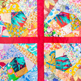 Patchwork quilt framed in red cloth Royalty Free Stock Image