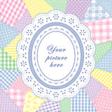 Patchwork Quilt, Oval Eyelet Lace Doily Frame. Pastel gingham & polka dot patchwork quilt with oval eyelet lace doily frame. Copy space for your favorite picture Royalty Free Stock Images