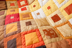 Patchwork quilt. Part of patchwork quilt as background. Handmade. Colorful blanket. Stock Photos