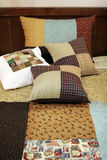 Patchwork quilt and pillows Stock Images