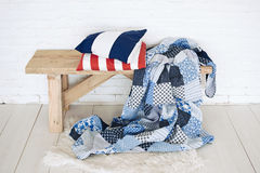 Patchwork quilt on rustic bench Royalty Free Stock Photography