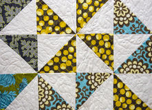 Patchwork quilt. Vintage quilt with squares and triangle pattern Royalty Free Stock Photography