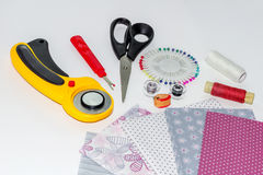 Patchwork quilting instruments, items and fabrics composition Royalty Free Stock Photography