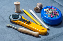 Patchwork sewing tools. On gray cloth Stock Photos