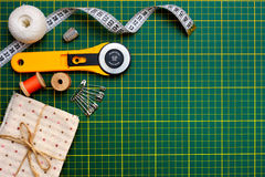 Patchwork sewing tools on green mat royalty free stock photo