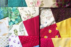 Patchwork squares. Patchwork quilt squares, quilt in progress, at design stage Royalty Free Stock Photo