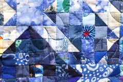 Patchwork squares. Tiny blue quilt squares, patchwork Stock Image
