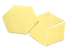 Patchwork Template Pieces. Cut from cardboard, the hexagon can be further cut to a triangle, a half hexagon and a diamond shape, thereby continuing the Stock Image
