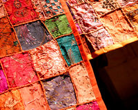 Patchwork textiles. Patch-worked textiles at an Indian market Royalty Free Stock Photos