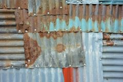 Tinplate full of patch patterns. Patchwork of tinplates full of spliced patches Royalty Free Stock Photo