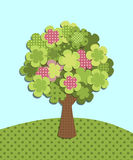 Patchwork tree. Patchwork green tree in a meadow Royalty Free Stock Images