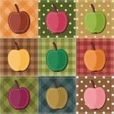 Patchworkhintergrund mit Äpfeln Stockfotos