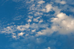 PATCHY CLOUD. White flocky cloud in blue sky Stock Images