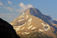Patchy glaciers in Glacier National Park. Mountain covered with scattered glaciers laying on it's surface Royalty Free Stock Images