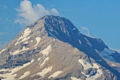 Patchy glaciers in Glacier National Park. Mountain covered with scattered glaciers laying on it's surface Royalty Free Stock Image