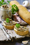 Pate from beef liver in a jar with bread slice. Stock Photo