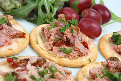 Pate Biscuit Canapes. Ardennes pate on biscuits __ shallow DoF Stock Photo