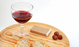 Pate, bread, glass of red wine, hazelnuts on wood plate Royalty Free Stock Images
