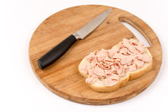 Pate on the bread with knife in the background Royalty Free Stock Image
