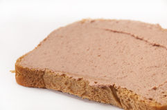 Pate on bread. Over white background Royalty Free Stock Photo